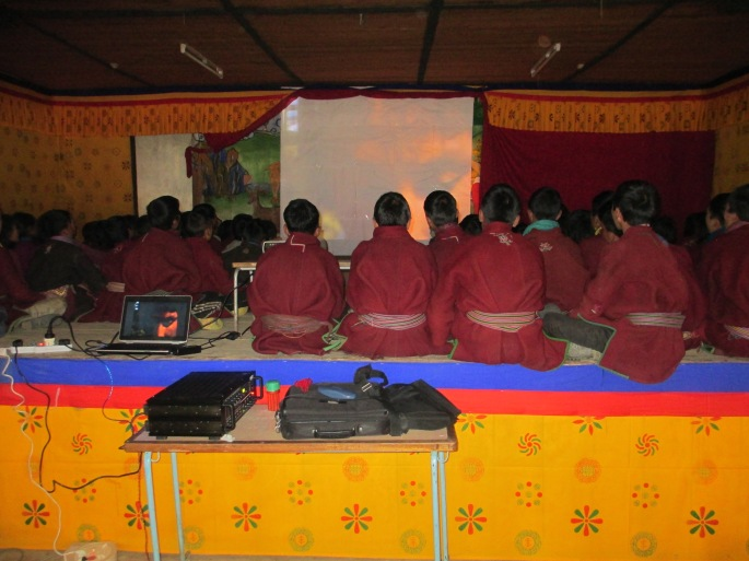 Merak school watching red panda documentary.JPG